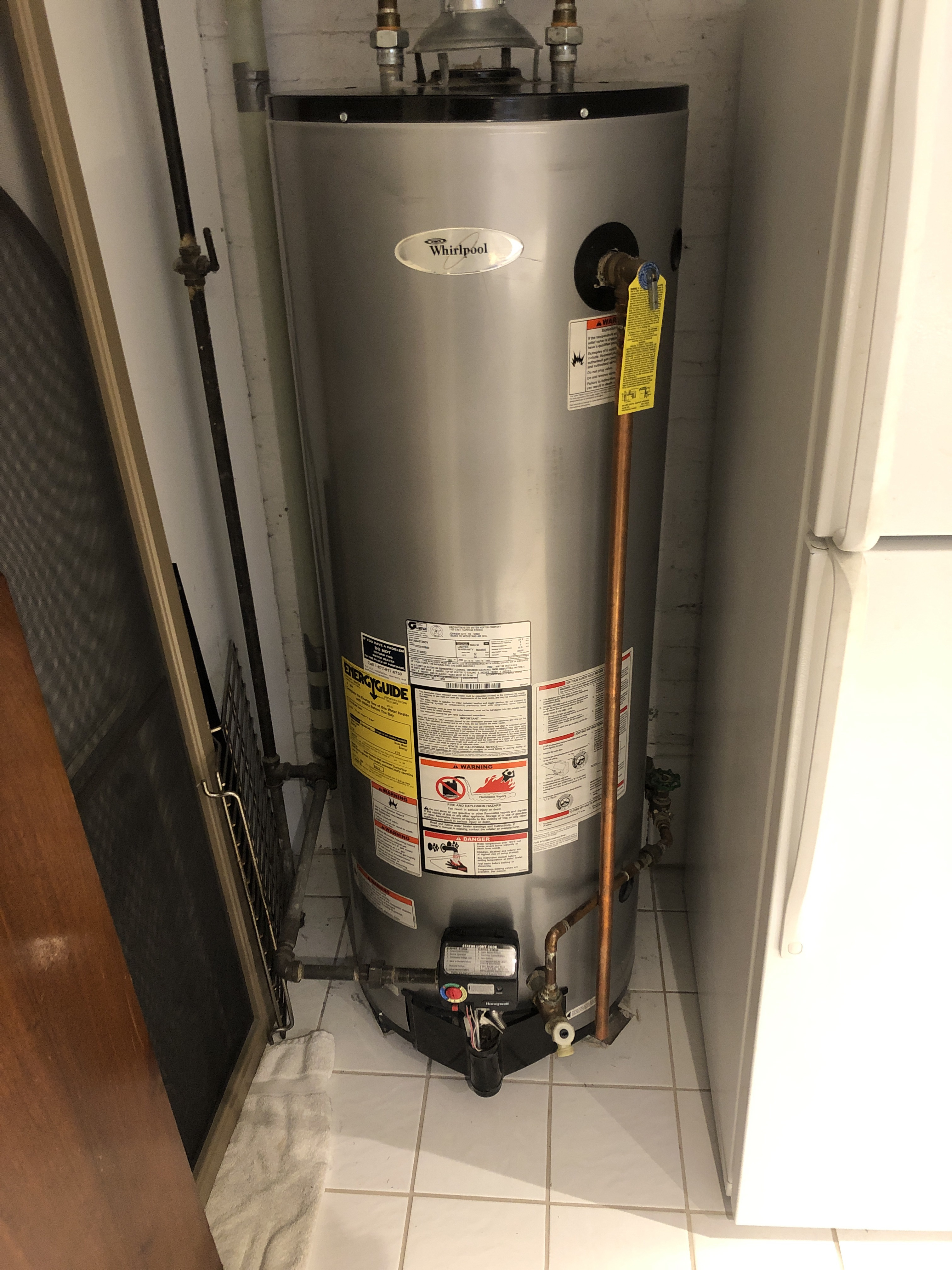 Arrived on call for ho heat. Found hot water heating flashing an upper sensor failure. Reset valve and relit pilot cycled unit. Unit fired up but recommended replacing unit soon