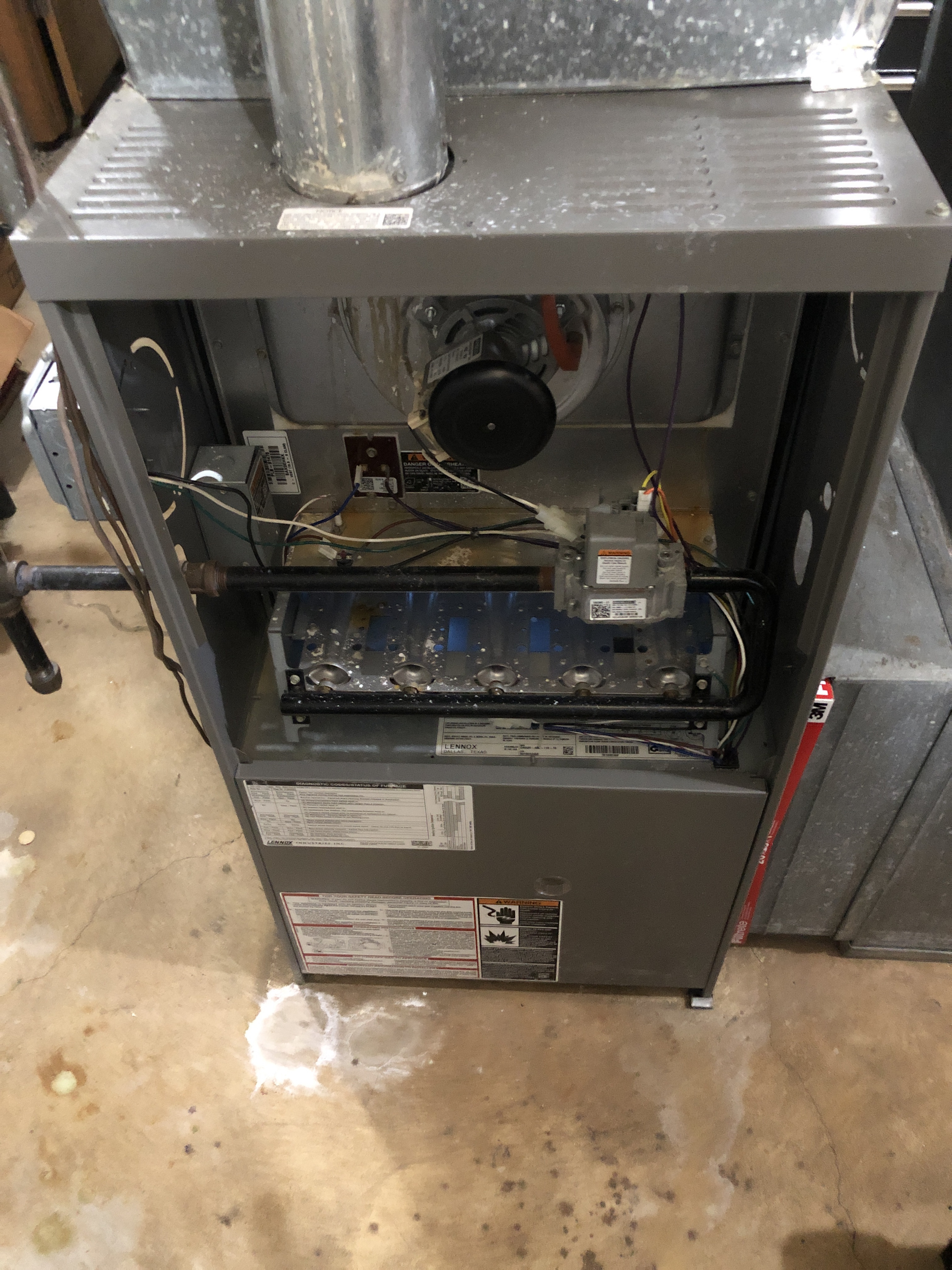 Furnace maintenance on a Lennox furnace.