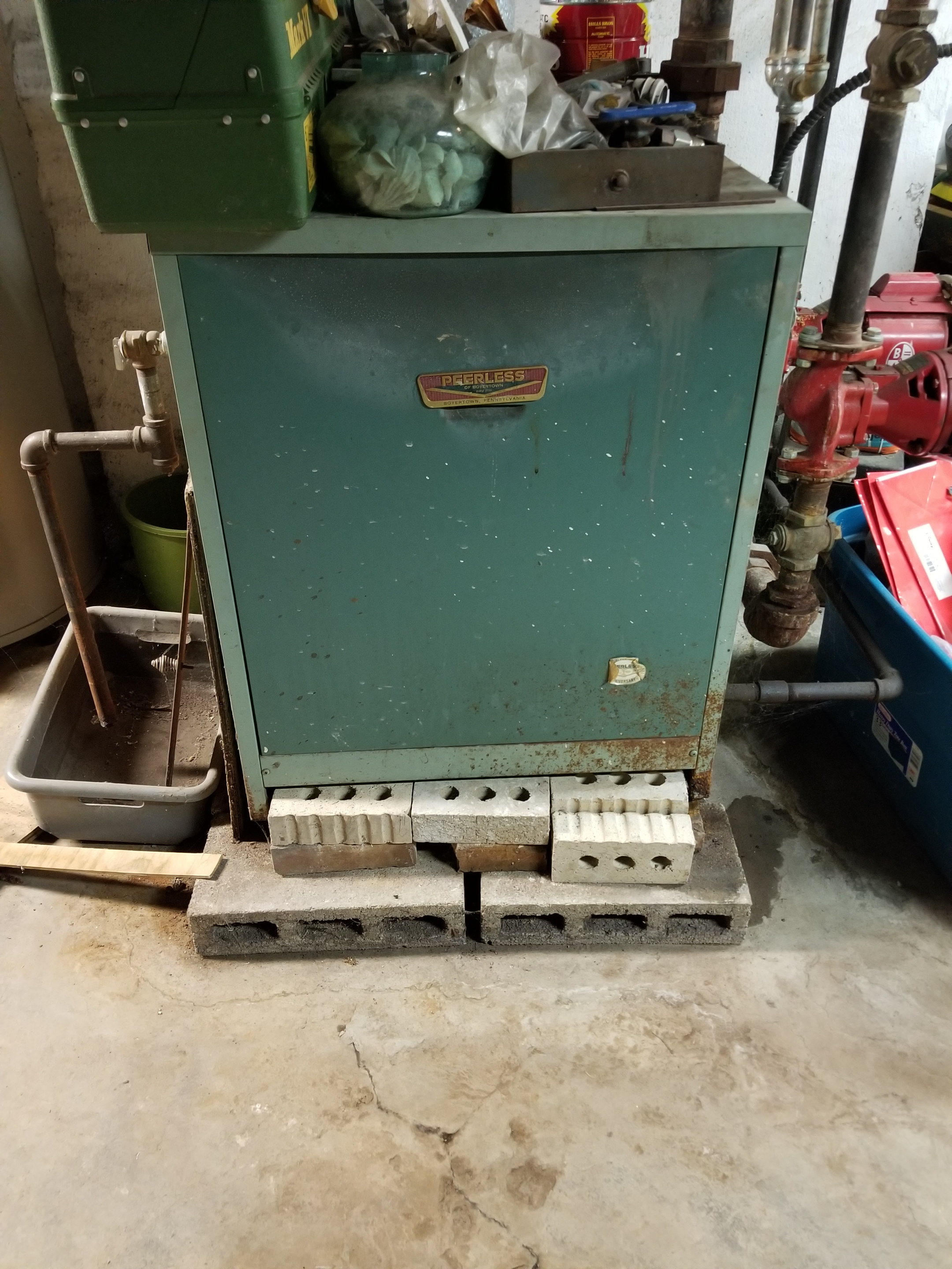 Recommended replacement of this old Peerless boiler for a new, high efficiency modern boiler.