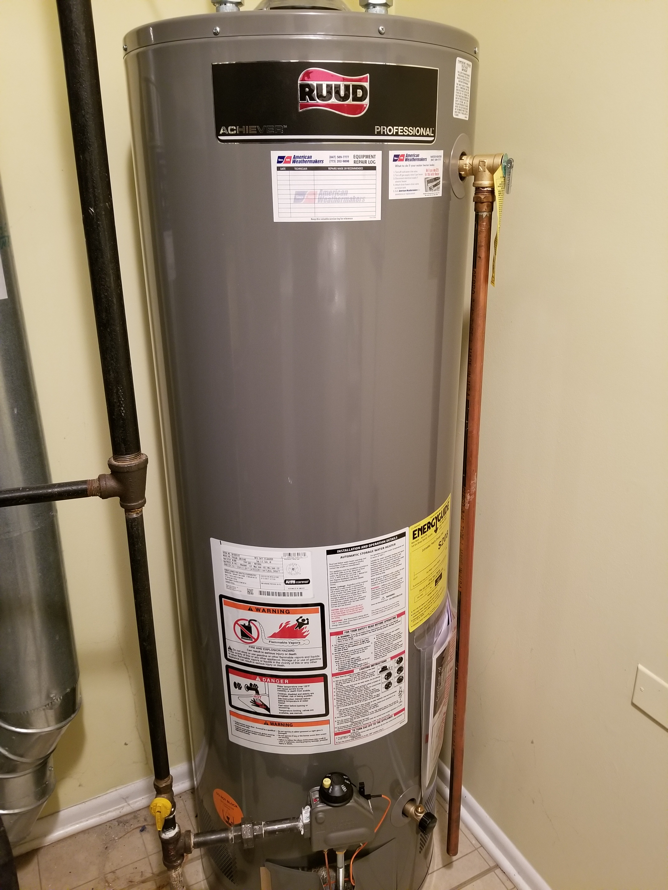 Replaced the old inefficient water heater with a new and more efficient RUUD water heater.