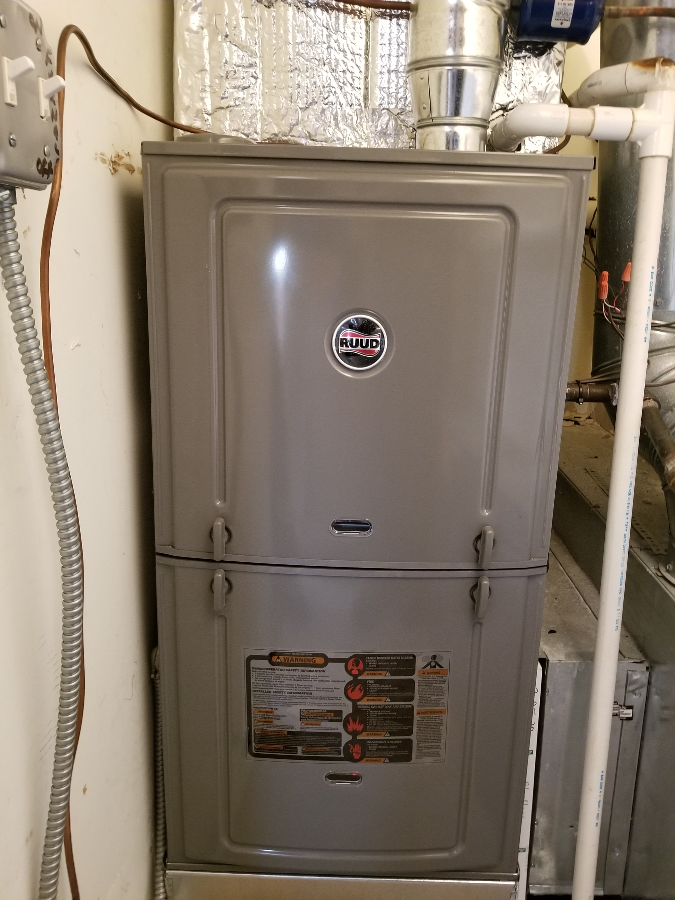 Removed an old worm out furnace and replaced it with a new efficient Ruud furnace.