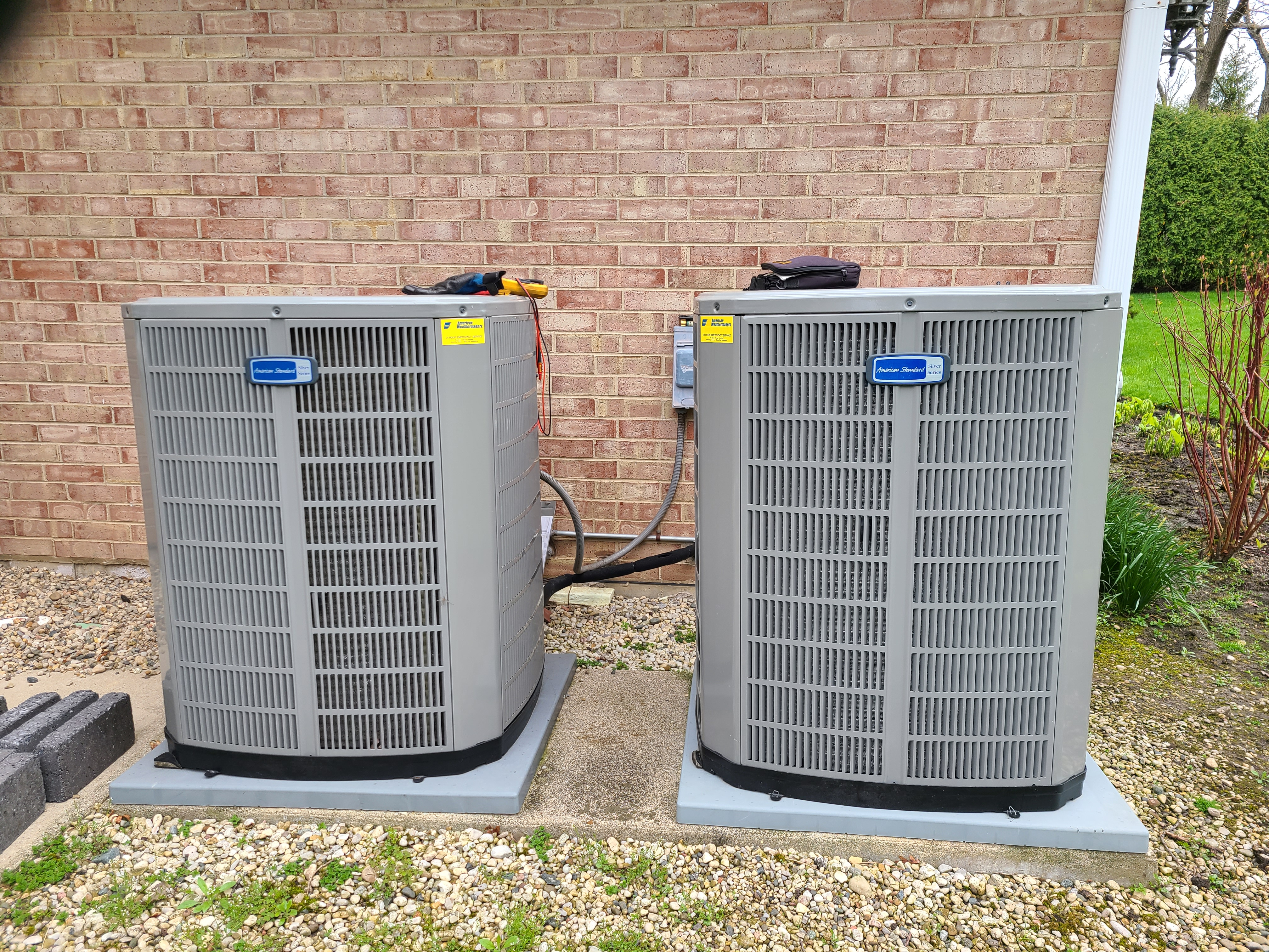 Two American Standard air conditioning systems cleaned and checked, ready for spring.