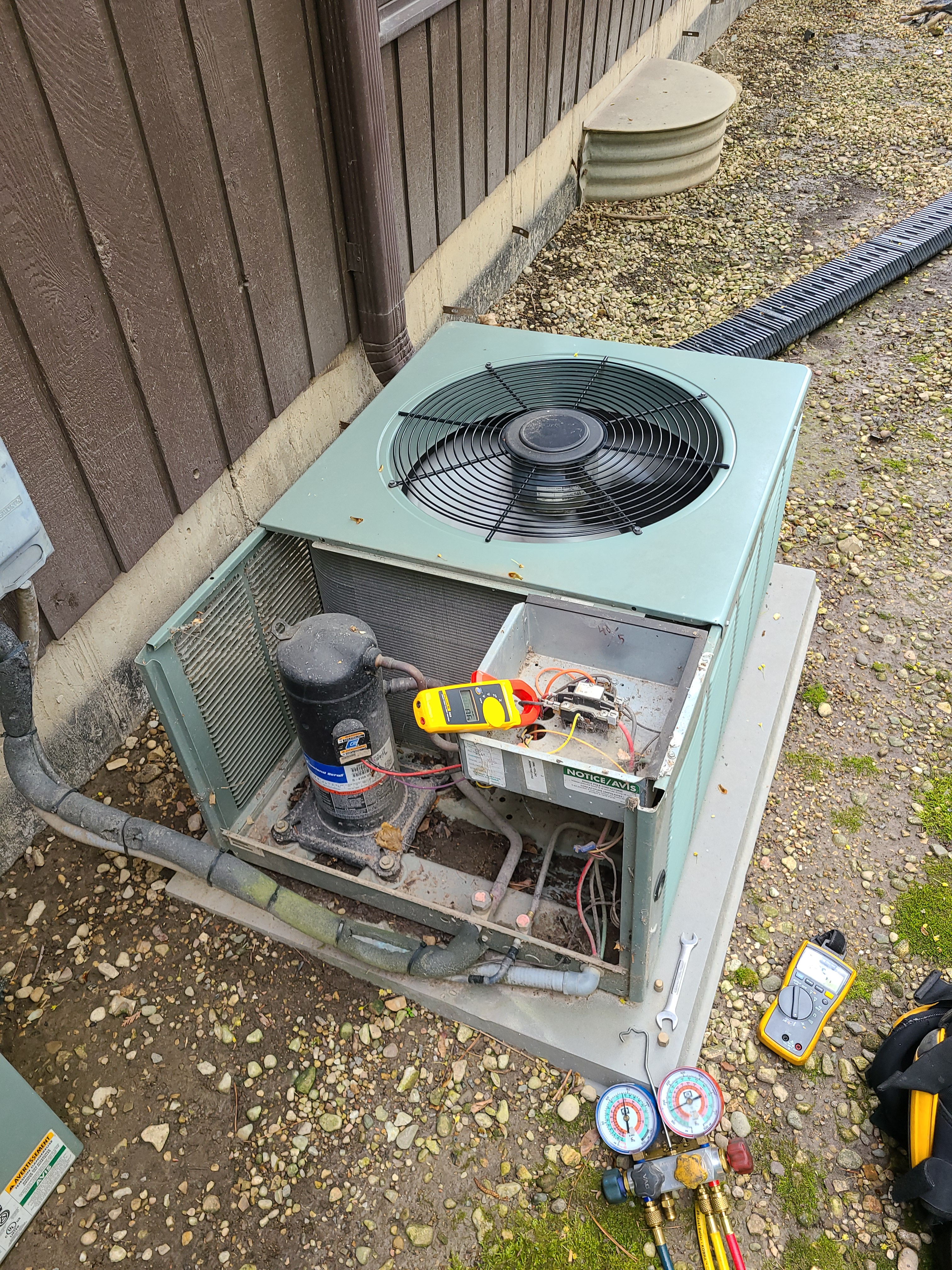 Rheem air conditioning system cleaned and checked, ready for spring.