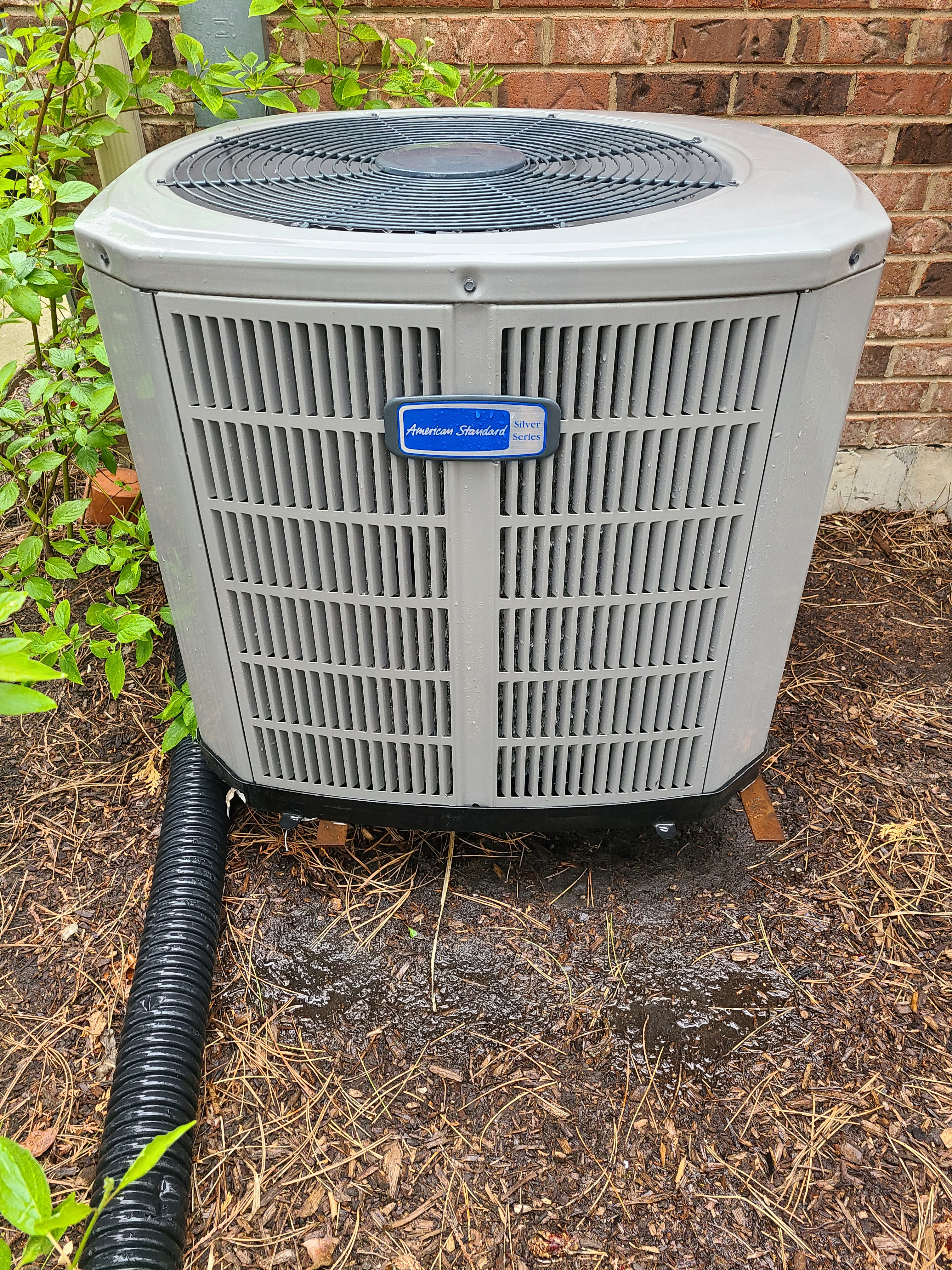 AC maintenance on an American Standard air conditioner.
