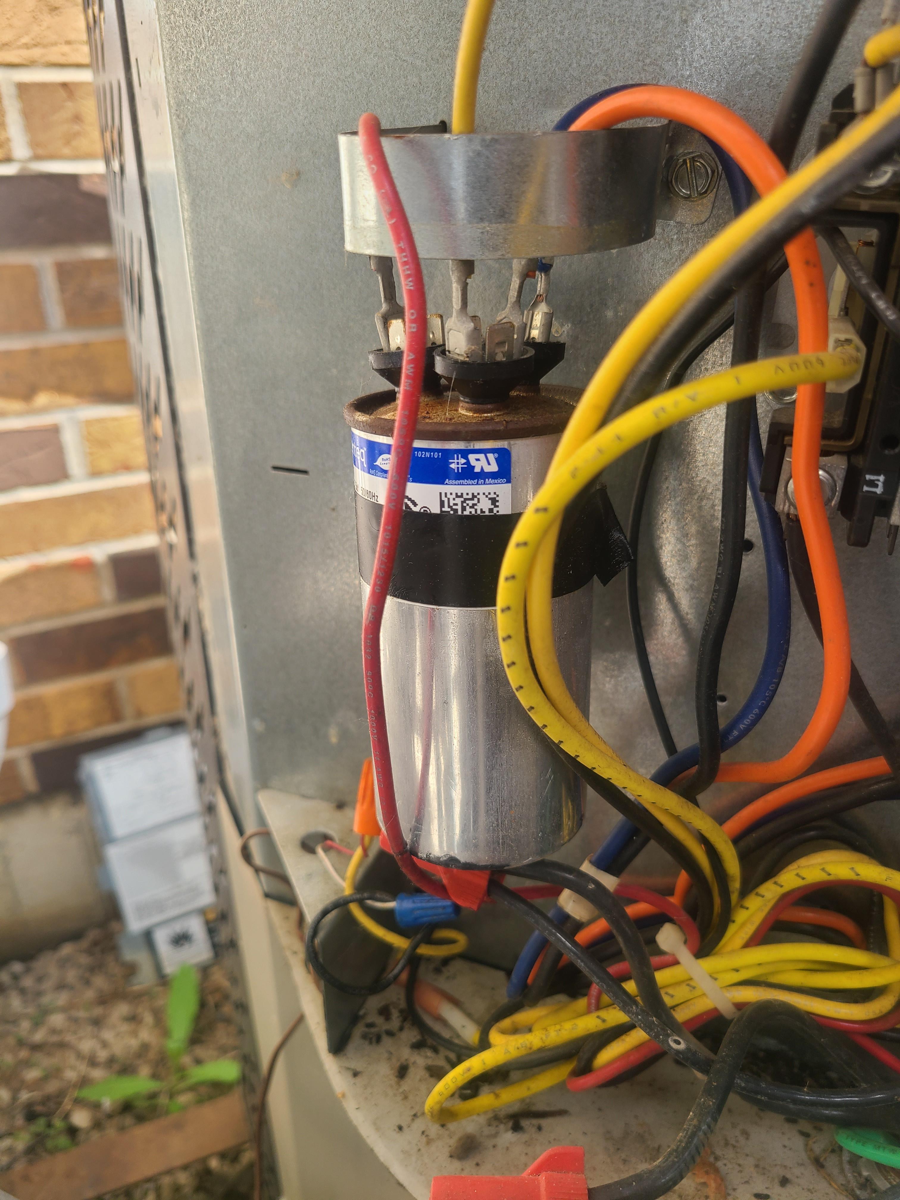 AC humming. Capacitor blown in condensing unit.