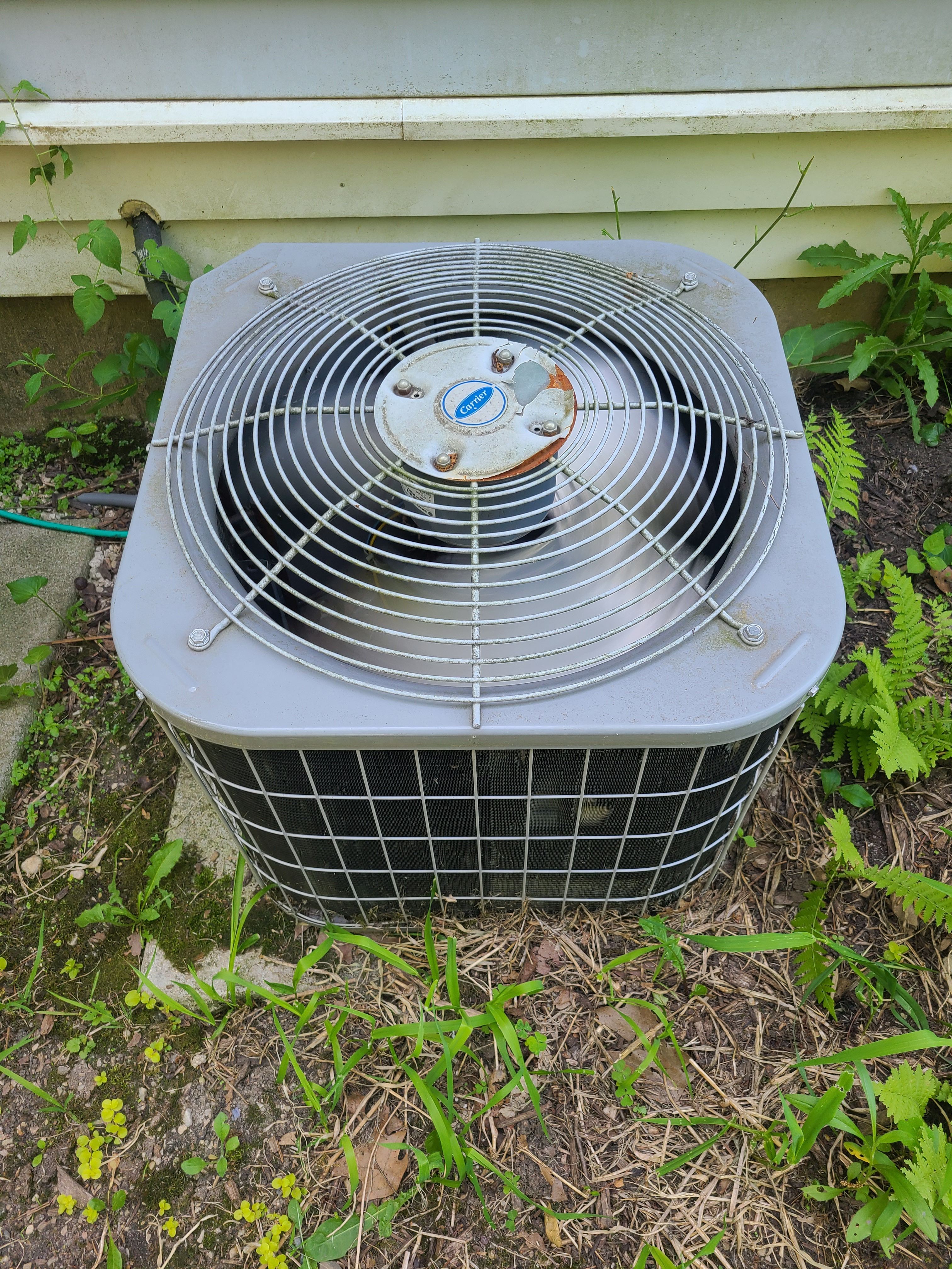 AC maintenance on old Carrier air conditioner.