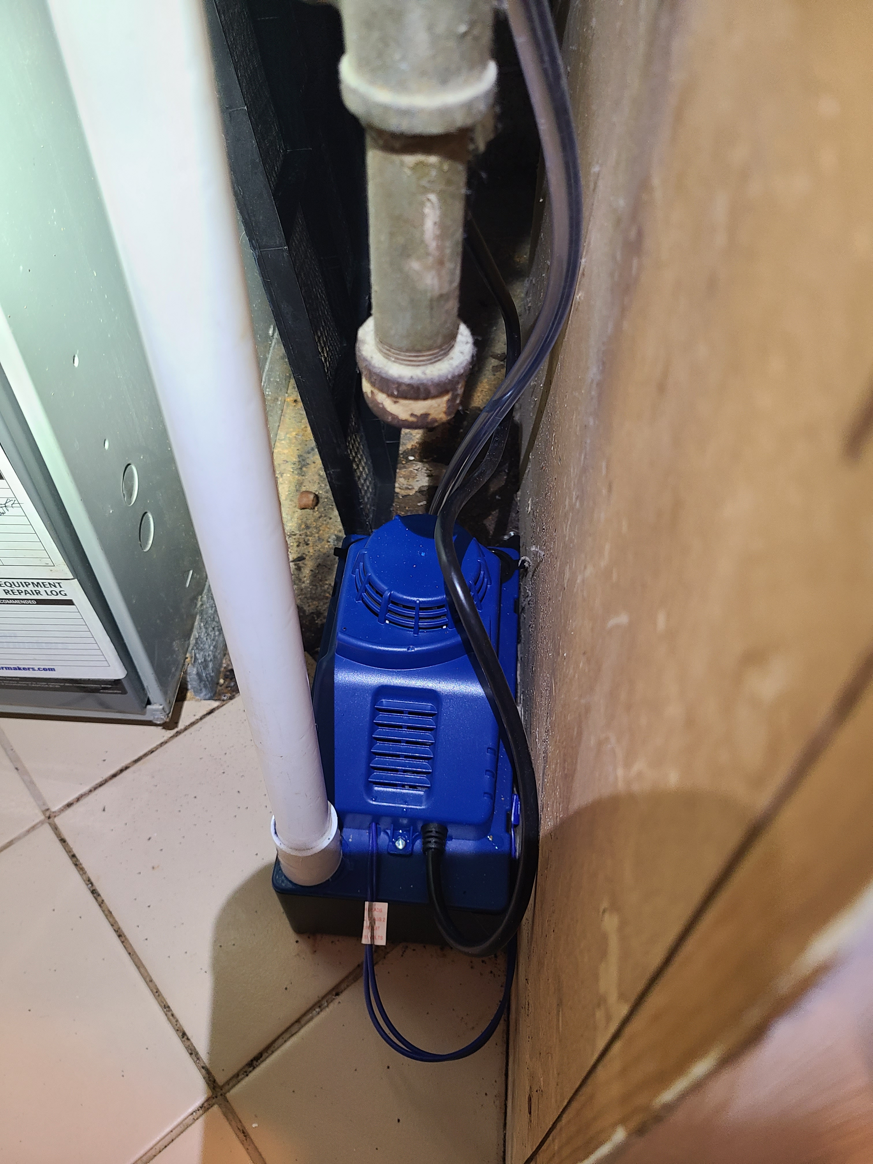 Old faulty condensate pump replaced with new