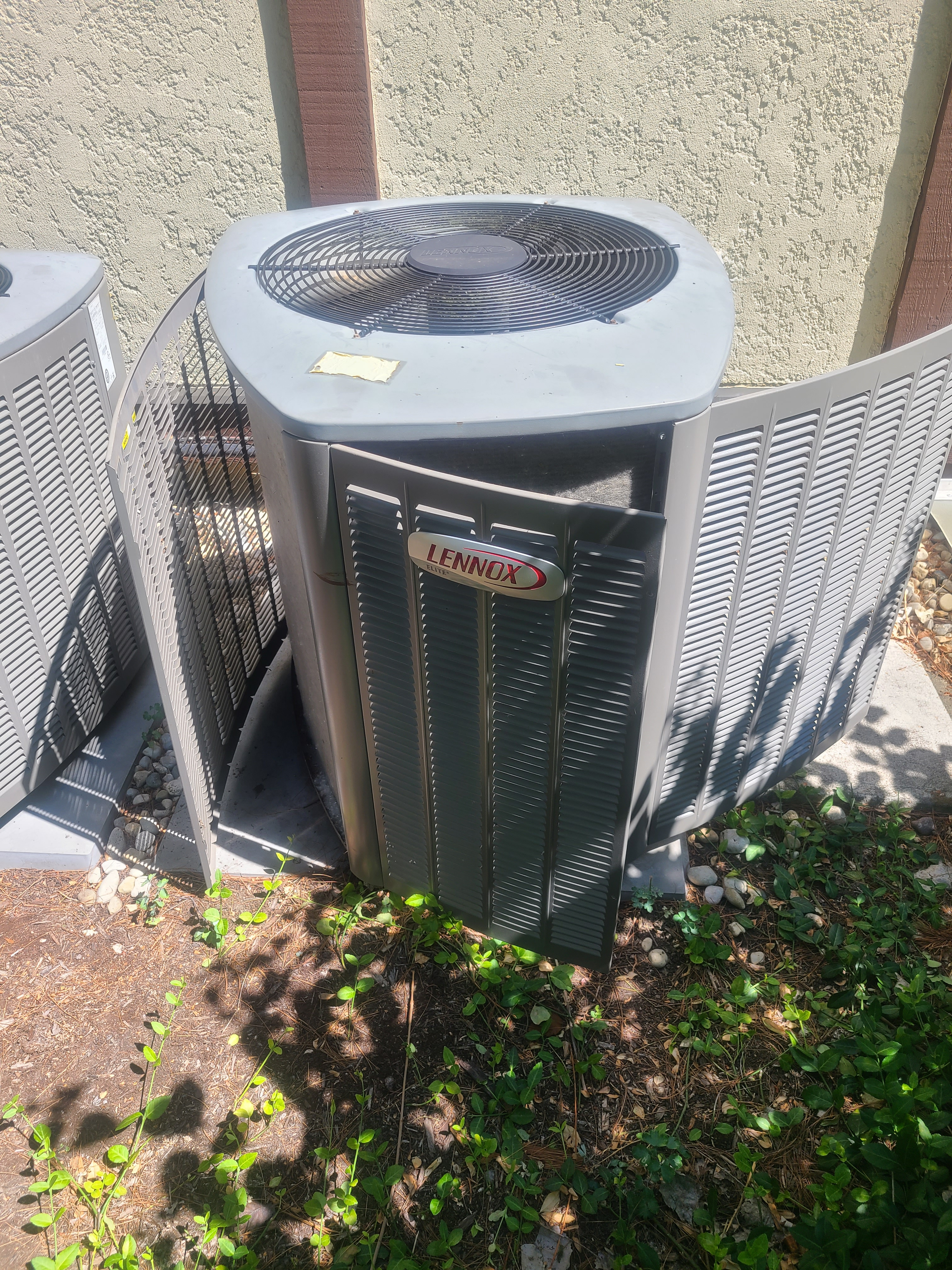 Cleaning condenser coil on a Lennox air conditioner.