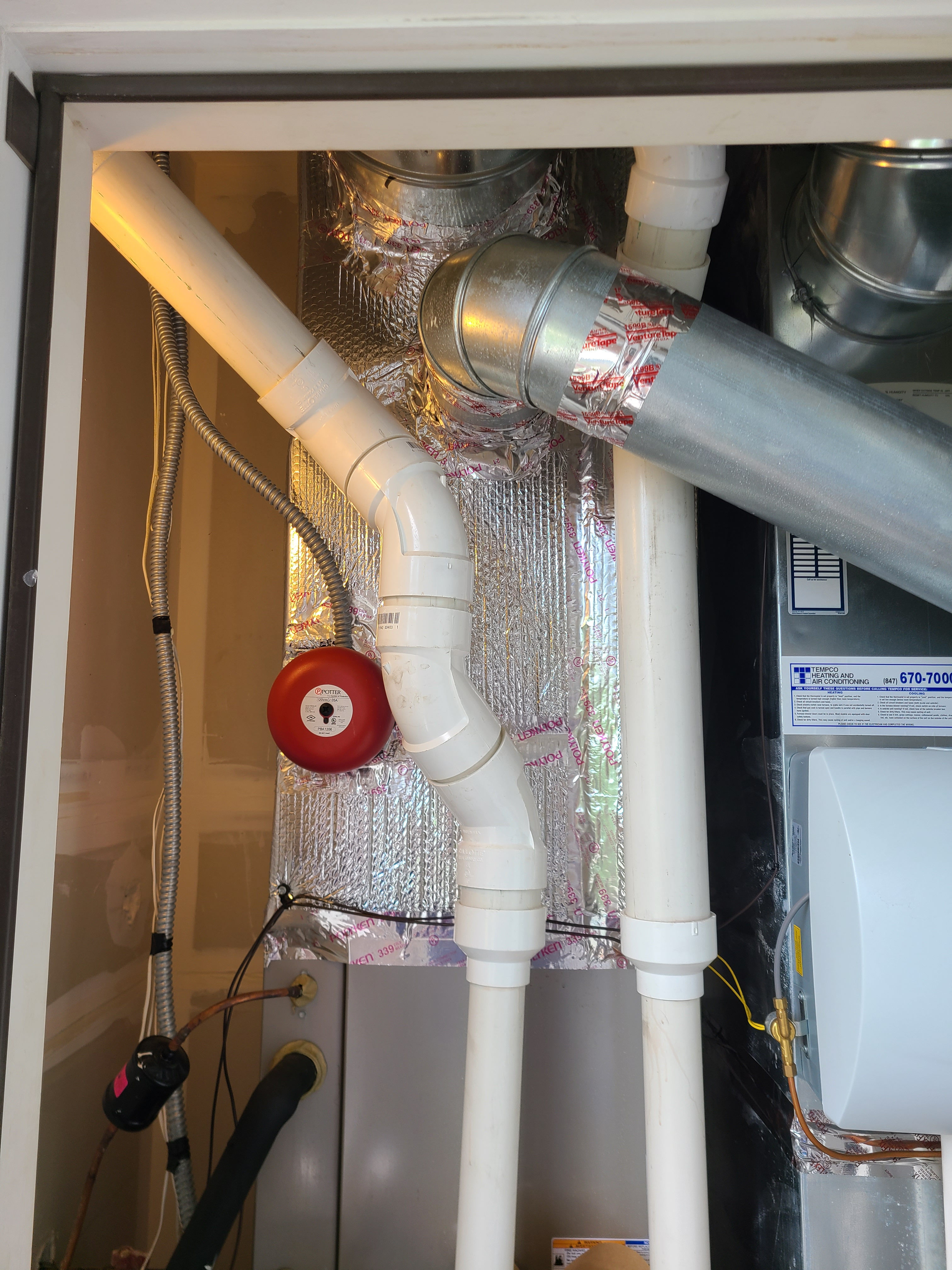 Wrapped plenum of carrier furnace to aid in efficiency and to help eliminate condensation