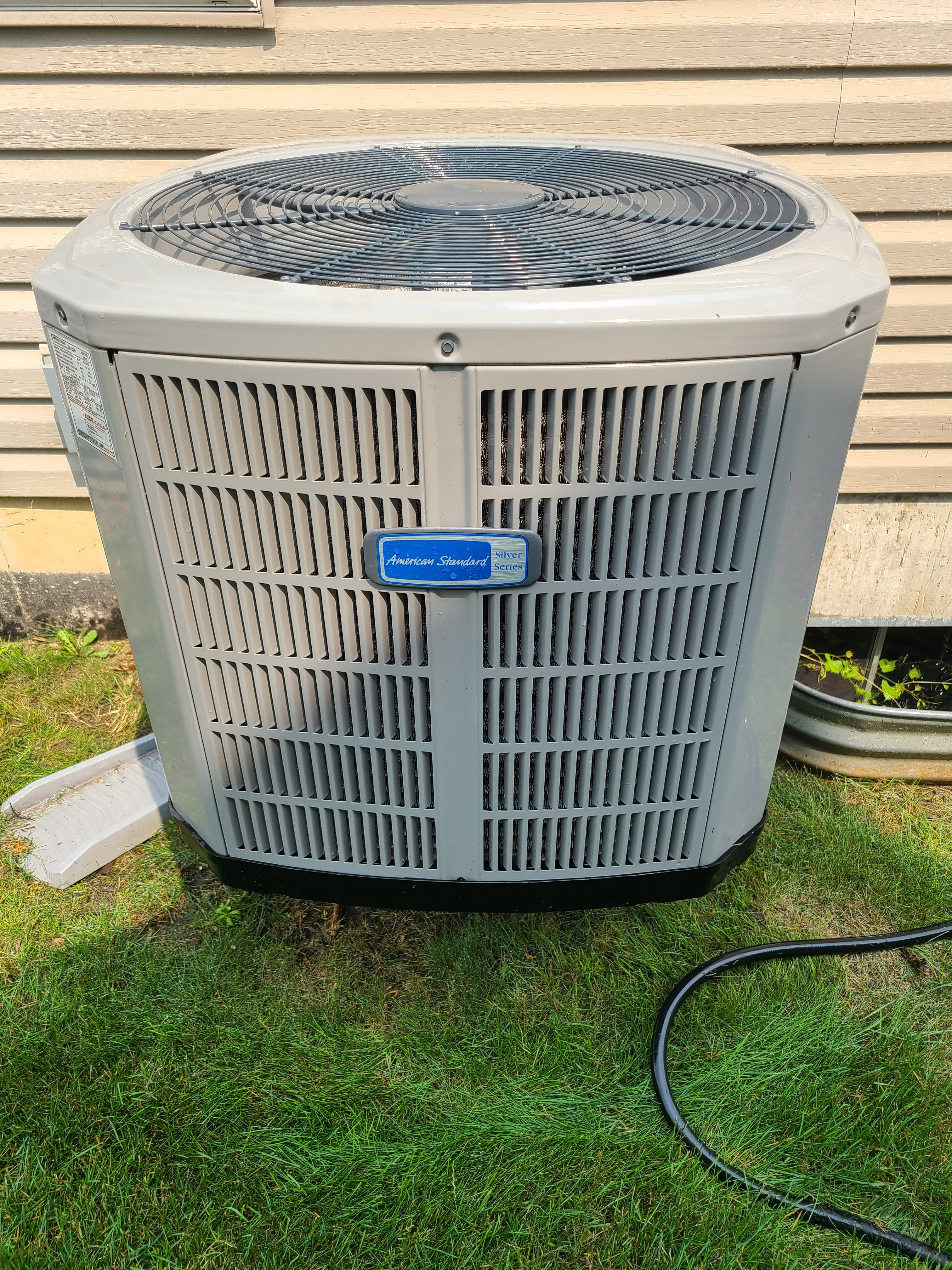 Overcharged American Standard air conditioner. Removed and unit is drawing 2 amps less.