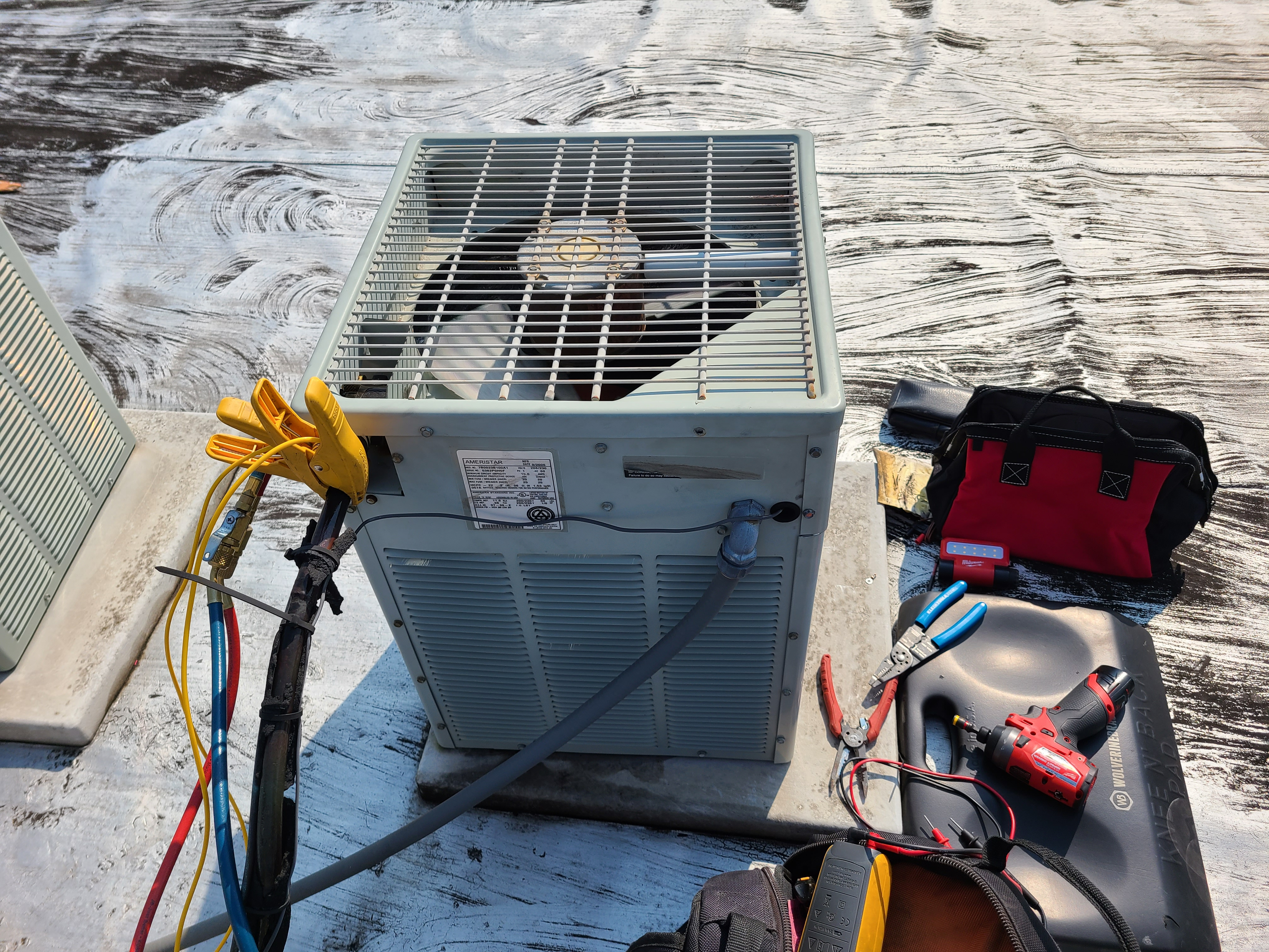 Checking systems charge and temperature on ac condenser.
